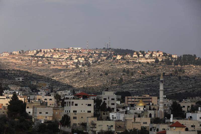 epa08222138 A general view of the Israeli settlement of Elon Moreh (back) as seen from the Palestinian village of Azmout near the West Bank City of Nablus, 16 February 2020. According to reports, Israeli Prime Minister Benjamin Netanyahu said an Israeli team will be working with US counterparts on 'sovereignty maps' including the Jordan Valley, the northern Dead Sea and all Jewish settlement in West Bank in light of the US President Trump's Middle East peace plan.  EPA/ALAA BADARNEH