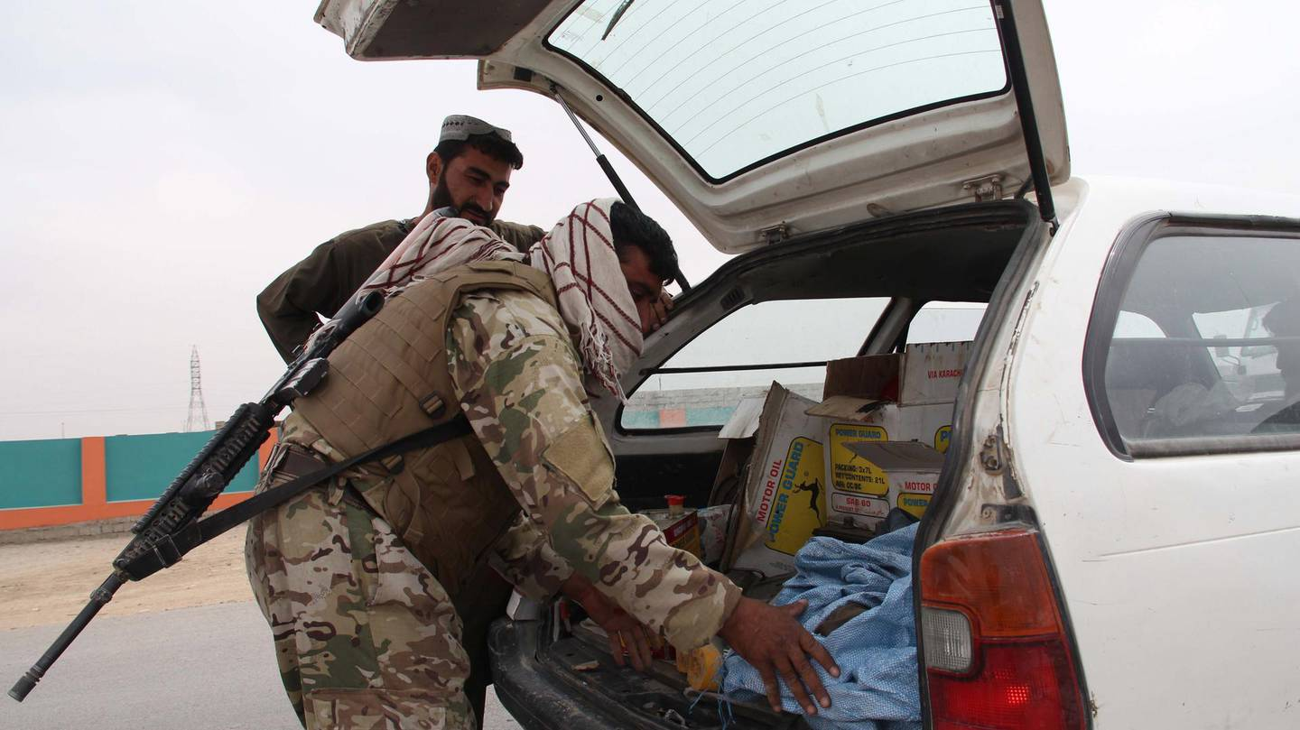epa09136972 Afghan security officials check people at a roadside checkpoint in Helmand, Afghanistan, 15 April 2021. The United States will began removing its remaining troops from Afghanistan on 01 May and the withdrawal is to be complete by September 11, the 20th anniversary of the terrorist attacks on New York and Washington that spurred the invasion, US President Joe Biden said on 14 April 2021.  EPA/WATAN YAR