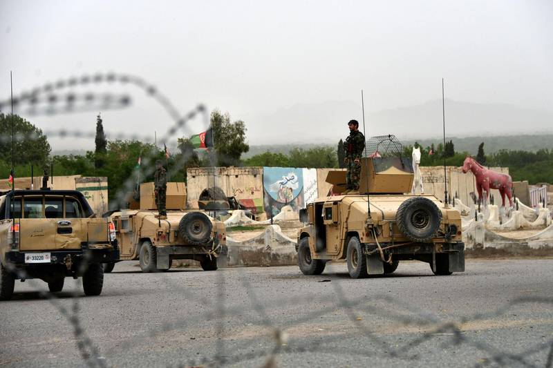 Afghan security forces stand on Humvee vehicles during a military operation in Arghandab district of Kandahar province on April 4, 2021. / AFP / JAVED TANVEER