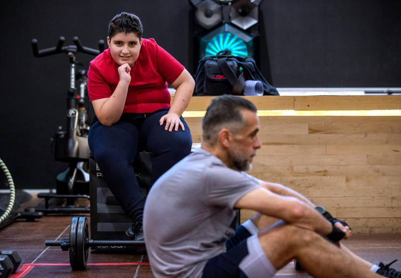 Ihsan Al Sakka does weight training and cardio excercises while his son, Abdulvahab, 14 looks on at the Abu Dhabi Country Club on June 1st, 2021. Victor Besa / The National.Reporter: Haneen Dajani for News