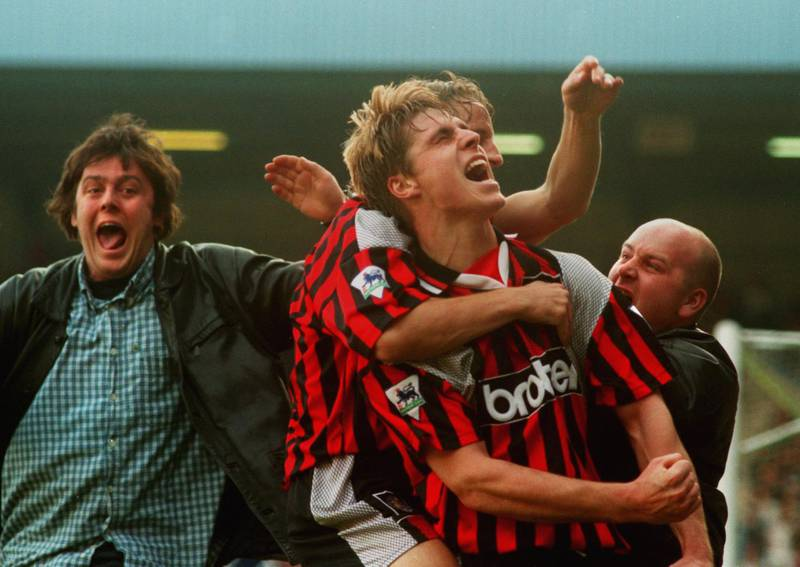 15 OCT 1994:  GARY FLITCROFT OF MANCHESTER CITY IS MOBBED BY A TEAMMATE AND TWO FANS AS HE CELEBRATES AFTER SCORING THE OPENING GOAL AGAINST QUEENS PARK RANGERS IN THEIR PREMIER LEAGUE MATCH IN LONDON. Mandatory Credit: Phil Cole/ALLSPORT