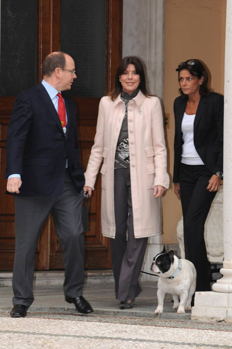 MONTE CARLO, MONACO - DECEMBER 17:  (L-R) Prince Albert II of Monaco, Princess Caroline of Hanover her dog Romeo and Princess Stephanie of Monaco arrive to attend the Christmas tree Party on December 17, 2008 in Monaco.  (Photo by Pascal Le Segretain/Getty Images)