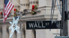 Wall Street slightly down on trade and oil price concerns