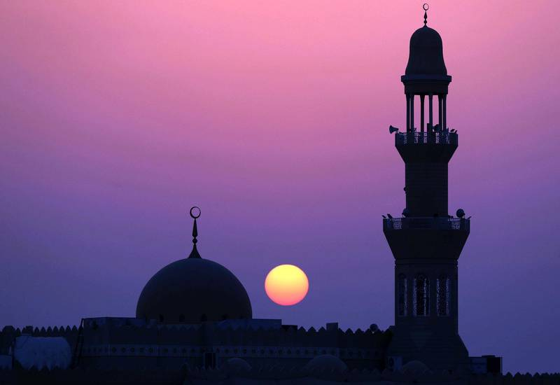 Abu Dhabi, United Arab Emirates - May 31st, 2018: Standalone. The sun sets over a mosque during Ramadan. Thursday, May 31st, 2018 at Al Bahya, Abu Dhabi. Chris Whiteoak / The National