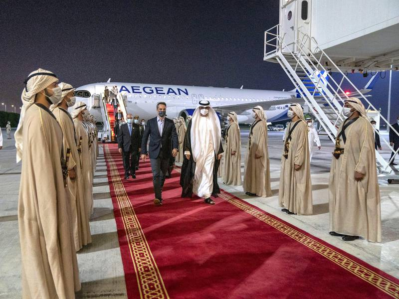 ABU DHABI, UNITED ARAB EMIRATES - November 17, 2020: HE Dr Sultan Ahmed Al Jaber, UAE Minister of State, Chairman of Masdar and CEO of ADNOC Group (R), receives HE Kyriakos Mitsotakis, Prime Minister of Greece (L), at the Presidential Airport.   ( Mohamed Al Hammadi / Ministry of Presidential Affairs ) ---