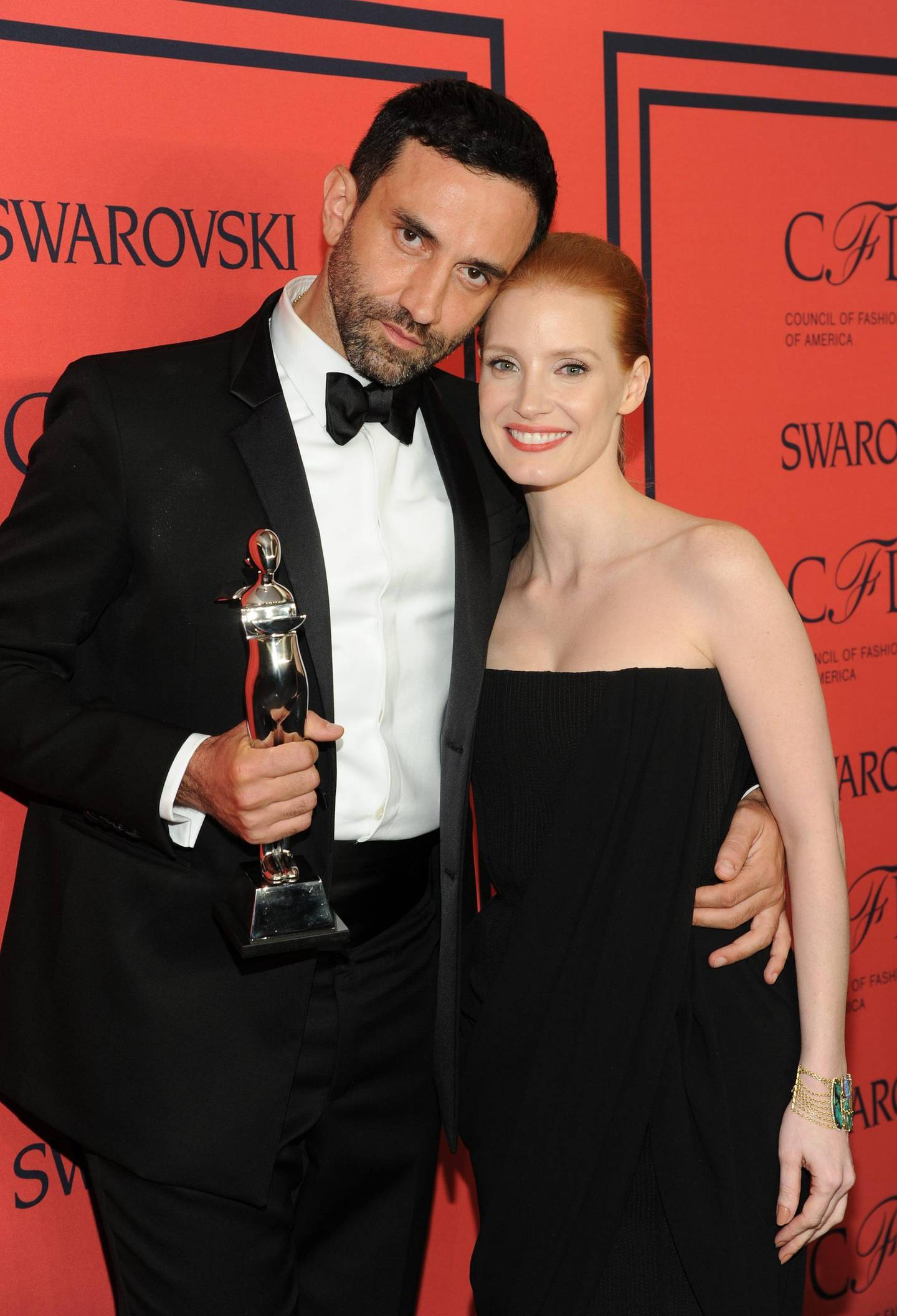 International Award honoree Riccardo Tisci, left, and actress Jessica Chastain pose in the press room at the 2013 CFDA Fashion Awards at Alice Tully Hall on Monday, June 3, 2013 in New York. (Photo by Evan Agostini/Invision/AP) *** Local Caption ***  2013 CFDA Fashion Awards Press Room.JPEG-0ccb2.jpg