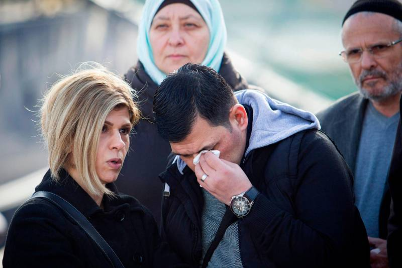 """Abdullah Kurdi and his siter Tima react in front of a Sea-Eye rescue ship named after his son and her nephew Alan Kurdi during its inauguration in Palma de Mallorca on February 10,  2019.  The former research vessel """"Professor Albrecht Penck"""" was rebaptised """"Alan Kurdi"""", after the Syrian boy who was drowned during a ship wreck in the Mediterranean Sea. / AFP / JAIME REINA"""