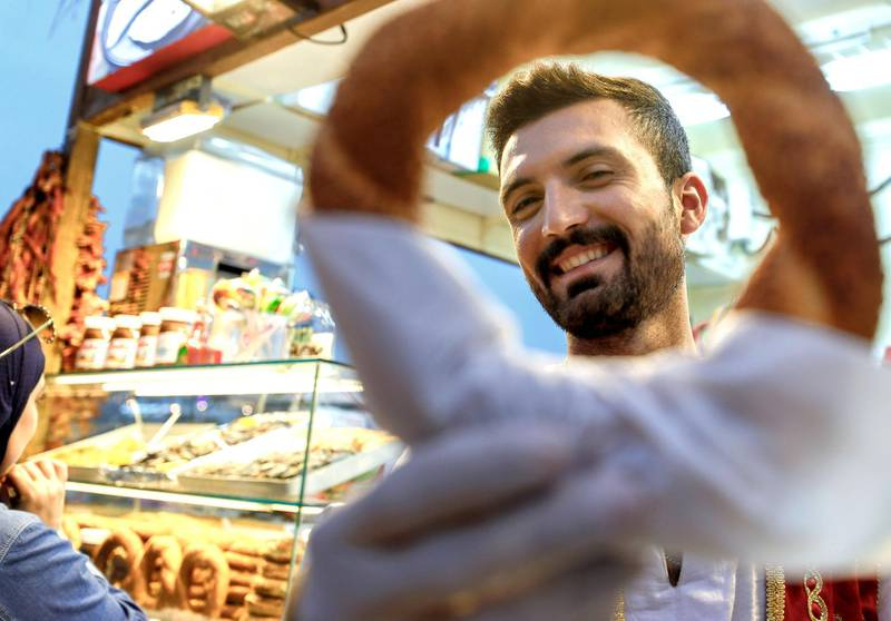 Abu Dhabi, United Arab Emirates, January 5, 2020.  Photo essay of Global Village.-- Azat Lale, 24, Morocco. Has been working for the K-14 Turkish pastry stall at the Global Village for three years now.Victor Besa / The NationalSection:  WKReporter:  Katy Gillett