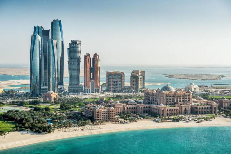 Abu Dhabi Hotels Record Strong Double-Digit Rise in Revenues in Q1 of 2019. Courtesy DCT Abu DhabiHelicopter point of view of sea and skyscrapers in Corniche bay in Abu Dhabi, UAE. Turquoise water and blue sky combined with building exterior.