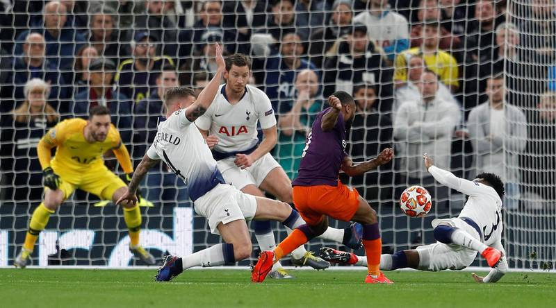 Soccer Football - Champions League Quarter Final First Leg - Tottenham Hotspur v Manchester City - Tottenham Hotspur Stadium, London, Britain - April 9, 2019  Manchester City's Raheem Sterling in action with Tottenham's Danny Rose before the incident is reviewed by VAR     REUTERS/Peter Nicholls