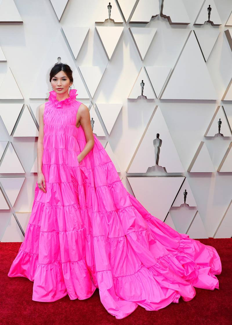 epa07394469 Gemma Chan arrives for the 91st annual Academy Awards ceremony at the Dolby Theatre in Hollywood, California, USA, 24 February 2019. Pink dress by Valentino. The Oscars are presented for outstanding individual or collective efforts in 24 categories in filmmaking.  EPA-EFE/ETIENNE LAURENT