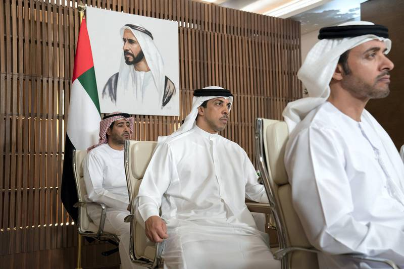 ABU DHABI, UNITED ARAB EMIRATES - March 16, 2020: HH Sheikh Hazza bin Zayed Al Nahyan, Vice Chairman of the Abu Dhabi Executive Council (R), HH Sheikh Mansour bin Zayed Al Nahyan, UAE Deputy Prime Minister and Minister of Presidential Affairs (C) and HE Ali Saeed Al Neyadi, President and Commissioner of the Customs and Authority (L), receive a briefing via video conference call from the Covid19 working group in the HQ of the National Emergency Crisis and Disasters Management Authority (NCEMA) (not shown).   ( Mohamed Al Hammadi / Ministry of Presidential Affairs ) ---