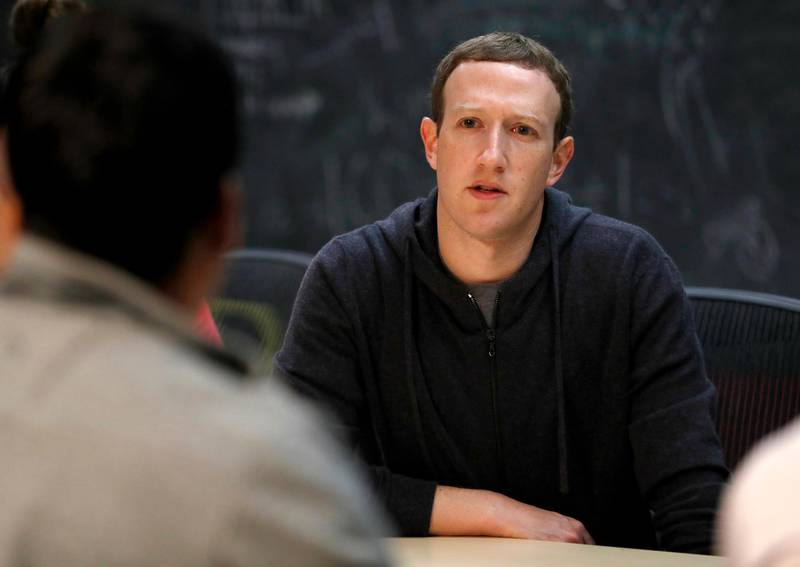"""FILE- In this Nov. 9, 2017, file photo, Facebook CEO Mark Zuckerberg meets with a group of entrepreneurs and innovators during a round-table discussion at Cortex Innovation Community technology hub in St. Louis. With Zuckerberg, """"its experiment, learn, experiment, learn,"""" said LinkedIn co-founder Reid Hoffman, who has known him since 2004. Hoffman said that is evident in Zuckerberg's enthusiasm for software, which can be overwritten to fix problems. (AP Photo/Jeff Roberson, File)"""