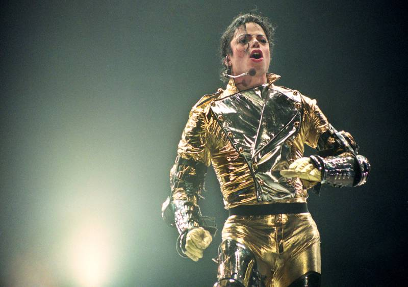 """AUCKLAND, NEW ZEALAND - NOVEMBER 10:  Michael Jackson performs on stage during is """"HIStory"""" world tour concert at Ericsson Stadium November 10, 1996 in Auckland, New Zealand. (Photo by Phil Walter/Getty Images)"""