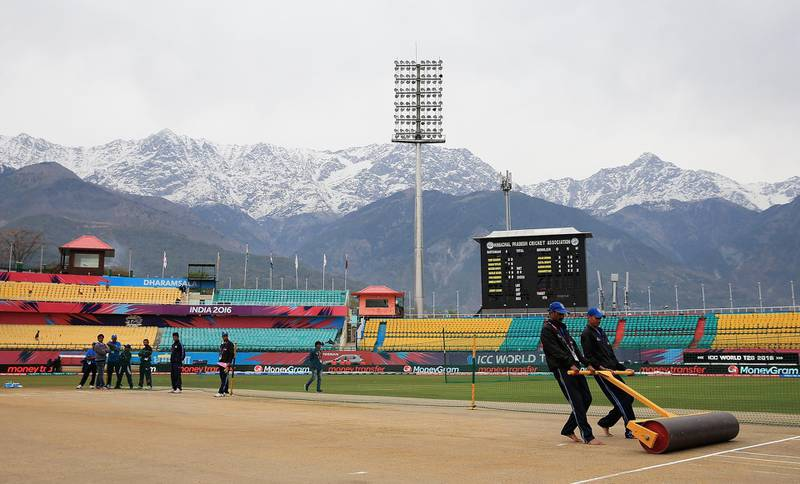 DHARAMSALA, INDIA - MARCH 24: Groundsmen prepare the pitch ahead of the Women's ICC World Twenty20 India 2016 match between England and the West Indies at the HPCA Stadium on March 24, 2016 in Dharamsala, India. (Photo by Matthew Lewis-ICC/ICC via Getty Images)