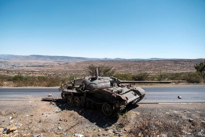 (FILES) In this file photo taken on February 26, 2021 A damaged tank stands on a road north of Mekele, the capital of Tigray on February 26, 2021. The United States voiced concern on March 2, 2021 over the arrests by Ethiopian authorities of four media workers in the conflict-hit northern Tigray region, saying the move was inconsistent with the government's commitments.  / AFP / EDUARDO SOTERAS