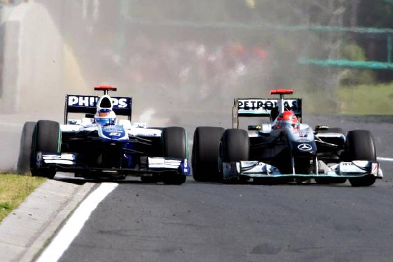 Michael Schumacher (GER) Mercedes GP MGP W01 squeezes Rubens Barrichello (BRA) Williams FW32 into the pit wall and onto the grass.Formula One World Championship, Rd 12, Hungarian Grand Prix, Race, Budapest, Hungary, Sunday 1 August 2010.