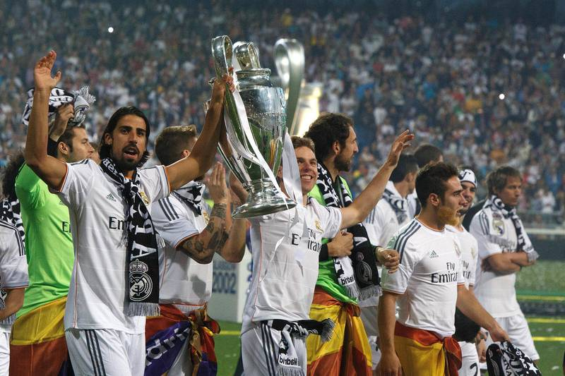 MADRID, SPAIN - MAY 25:  Real Madrid player Sami Khedira (L) lifts the trophy during the Real Madrid celebration the day after winning the UEFA Champions League final at Santiago Bernabeu Stadium on May 25, 2014 in Madrid, Spain. Real Madrid CF achieves their tenth European Cup at Lisbon at Lisbon 12 years later.  (Photo by Pablo Blazquez Dominguez/Getty Images)