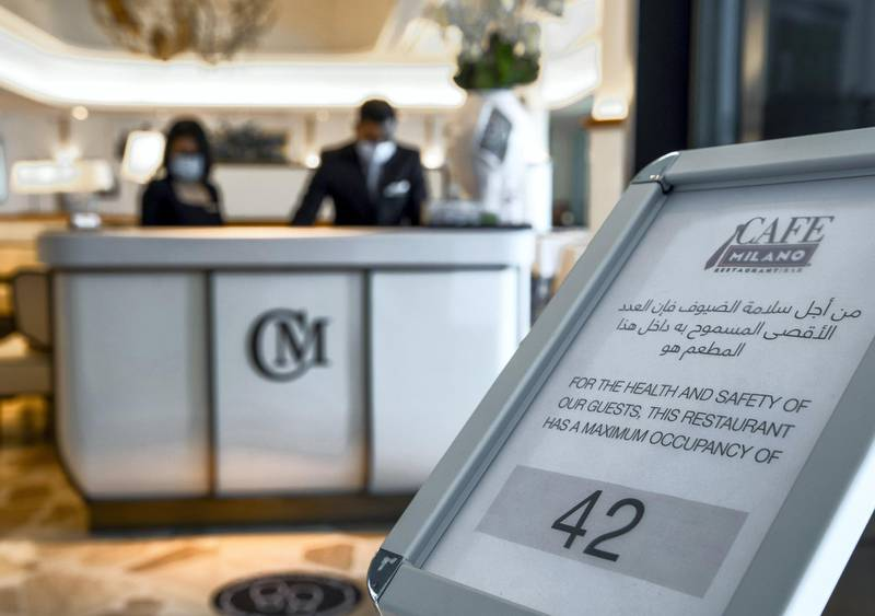 Abu Dhabi, United Arab Emirates, June 15, 2020.    Maximum occupancy sign at the reception of the Cafe Milano at the Four Seasons Hotel, Abu Dhabi.Victor Besa  / The NationalSection:  IfReporter:  Janice Rodrigues