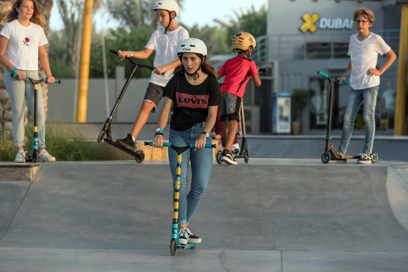 DUBAI, UNITED ARAB EMIRATES. 12 October 2017.  Skater girl article. A groth in girls taking up wheeled extreme sports has been noticed at the X Dubai Skate Park next to Kite Beach. Lea Salem (Canada 13) on her push scooter. (Photo: Antonie Robertson/The National) Journalist: Nick Webster. Section: National.