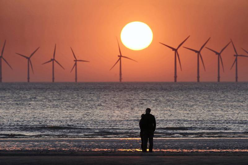 WALLASEY, ENGLAND - MAY 23:  The sun sets behind the wind turbines of Burbo Bank Offshore Wind Farm in the Irish Sea on May 23, 2018 in Wallasey, England.  (Photo by Christopher Furlong/Getty Images)
