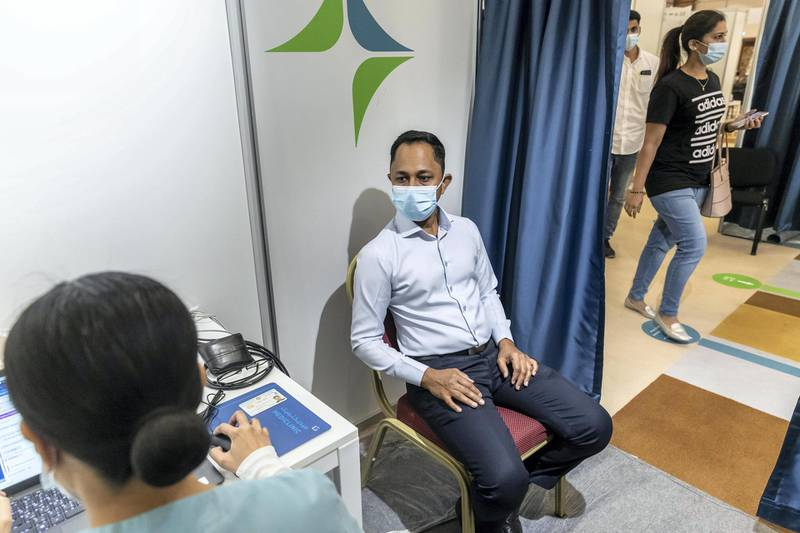 Mr Lateef Painatprepares to get vaccinated at the newly opened Al Barsha Hall, Vaccination Centre that are administering 4000 vaccinations a day on May 5th, 2021. Antonie Robertson / The National.Reporter: Nick Webster for National.