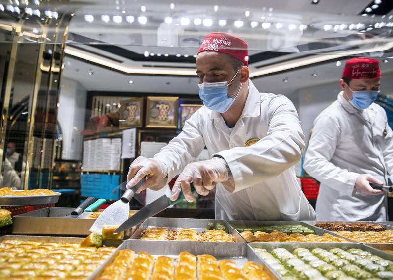 DUBAI, UNITED ARAB EMIRATES. 11 JUNE 2020. Staff of Hafiz Mustafa in facemasks at their shop in Dubai Mall.(Photo: Reem Mohammed/The National)Reporter:Section: