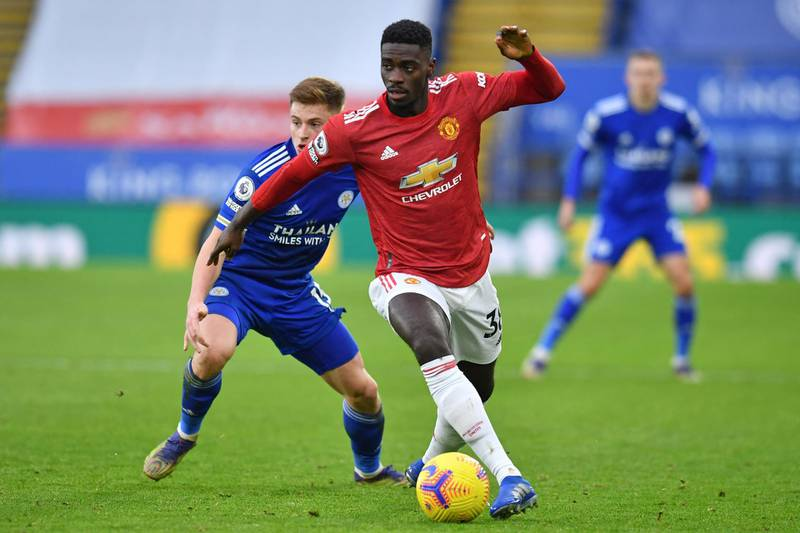 Manchester United's Congo-born English defender Axel Tuanzebe looks to play a pass during the English Premier League football match between Leicester City and Manchester United at King Power Stadium in Leicester, central England on December 26, 2020. (Photo by Glyn KIRK / POOL / AFP) / RESTRICTED TO EDITORIAL USE. No use with unauthorized audio, video, data, fixture lists, club/league logos or 'live' services. Online in-match use limited to 120 images. An additional 40 images may be used in extra time. No video emulation. Social media in-match use limited to 120 images. An additional 40 images may be used in extra time. No use in betting publications, games or single club/league/player publications. /