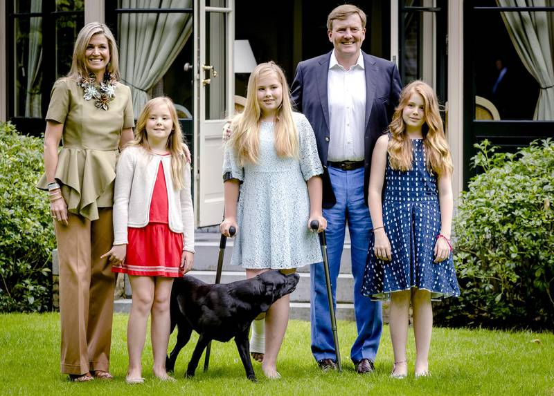 Dutch King Willem Alexander, Queen Maxima and (from L) Princess Ariane, Princess Amalia and Princess Alexia pose during the yearly photo shoot at Wassenaar on July 8, 2016. (Photo by Sander Koning / ANP / AFP) / Netherlands OUT