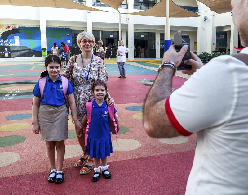 Abu Dhabi, U.A.E., September 2, 2018.  Pupils heading to school for the first day after the summer break at the Pearl Academy School on Muroor Road.--  Snap shots before class.  Mother Gergana and daughters, Adriana-8 year-4 and Daria-4, FS2.Contact: Victor Besa / The NationalSection:  NAReporter:  Anam Rizvi