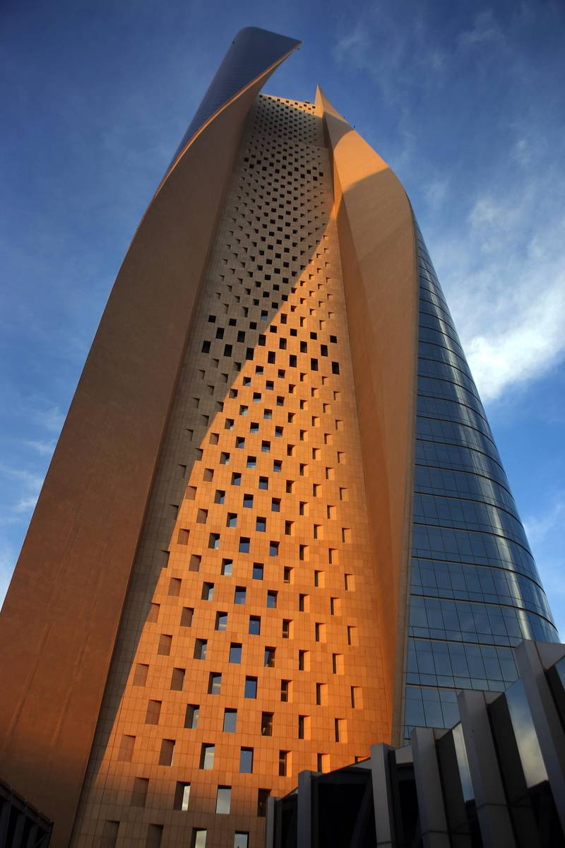 A picture taken on December 19, 2014 shows a view of al-Hamra Tower in Kuwait City. The tower is the tallest skyscraper in Kuwait and one of the top 10 tallest towers in the world. The tower is 450 metre-high and has 77 floors and 100,000 square meters of commercial and office space, as well as movie theatres, a rooftop restaurant and a spa.   AFP PHOTO / YASSER AL-ZAYYAT (Photo by YASSER AL-ZAYYAT / AFP)