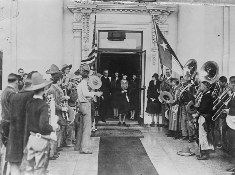 March 1929:  Mrs Hoover (Lou Henry) (1875 - 1944), wife of US President Herbert Clark Hoover, leaves to be greeted by a brass band.  (Photo by Fox Photos/Getty Images)