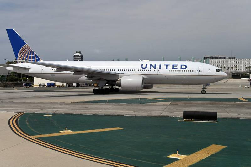 """(FILES) In this file photo a United Airlines plane taxis at Los Angeles International Airport on September 27, 2019. United Airlines has scheduled of two public events for June 29, 2021 raising expectations it will announce orders for more than 200 new Airbus and Boeing planes, an aviation industry expert said on June 28, 2021. The big carrier invited reporters to Newark Airport to join Chief Executive Scott Kirby on Tuesday morning for an event focused on """"the future of our airline,"""" according to an invitation sent last week.  / AFP / Daniel SLIM"""