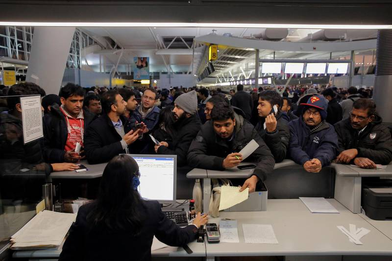 Passengers surround a customer service desk for Air India following a series of delays in the departure area of Terminal 4 at John F. Kennedy International Airport in New York City, U.S. January 7, 2018.  REUTERS/Andrew Kelly