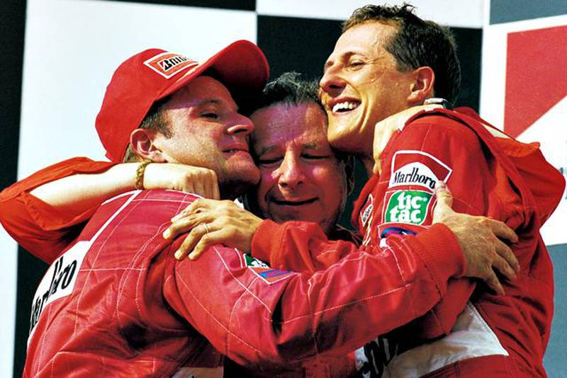 FILE - OCTOBER 04, 2012:  Michael Schumacher has announced his retirement from Formula One after a career spanning two spells during which he won a total of seven world titles, including five straight titles during his time with Ferrari. 19 Aug 2001:  Ferrari driver Rubens Barrichello, sporting director Jean Todt and Michael Schumacher celebrate after the Formula One Hungarian Grand Prix held at the Hungaroring in Budapest, Hungary.  Michael Schumacher won the race securing the Drivers Championship for the fourth time. \ Mandatory Credit: AllsportUK  /Allsport