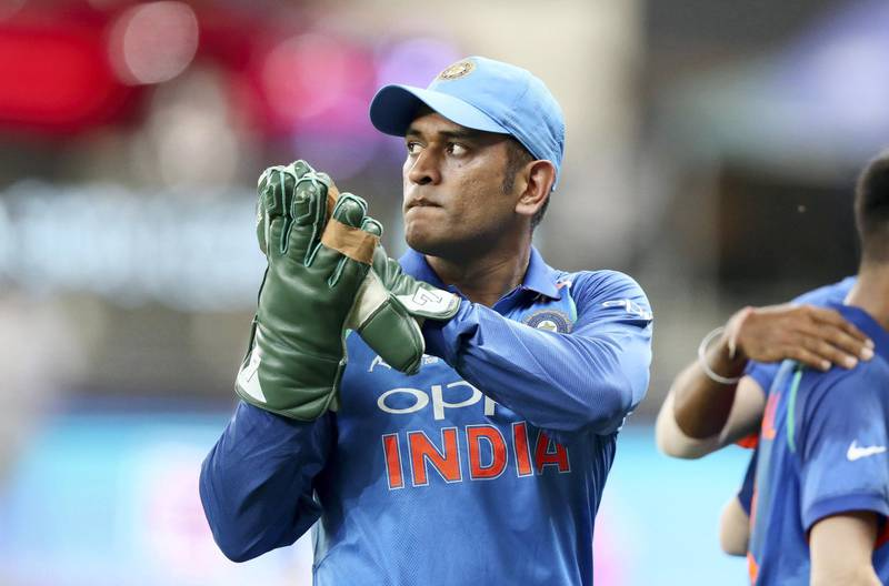 DUBAI , UNITED ARAB EMIRATES, September 19 , 2018 :- MS Dhoni , wicketkeeper of India after the first inning during the  Asia Cup UAE 2018 cricket match between Pakistan vs India held at Dubai International Cricket Stadium in Dubai. ( Pawan Singh / The National )  For Sports. Story by Paul