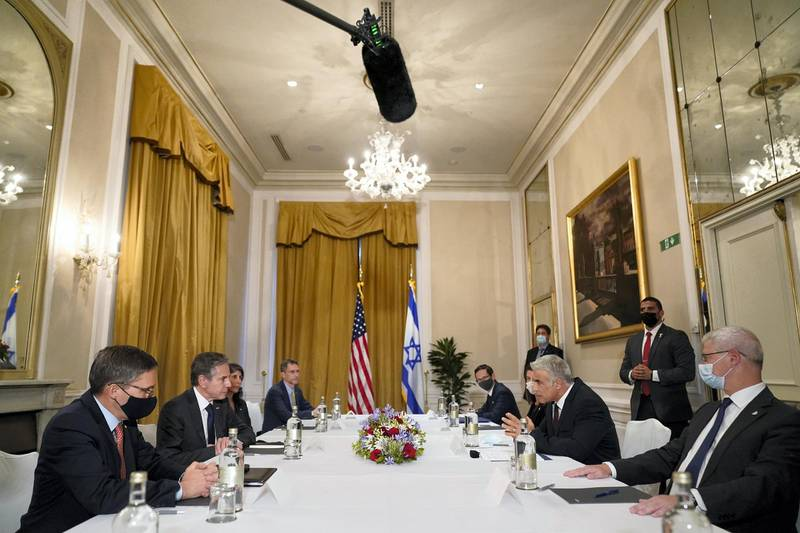Secretary of State Antony Blinken, second from left, meets with Israeli Foreign Minister Yair Lapid in Rome, Sunday, June 27, 2021. Blinken is on a week long trip in Europe traveling to Germany, France and Italy. (AP Photo/Andrew Harnik, Pool)