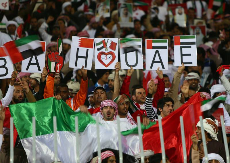 Bahraini and Emirati supporters cheer prior the start of the Gulf Cup's final football match between United Arab Emirates and Iraq on January 18, 2013 in Manama . AFP PHOTO/MARWAN NAAMANI  *** Local Caption ***  289292-01-08.jpg