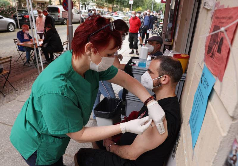 BERLIN, GERMANY - JUNE 13: A medical assistant inoculates a man with the Johnson and Johnson Janssen vaccine against Covid-19 during a local vaccination drive at the Revolte Bar in Friedrichshain district on June 13, 2021 in Berlin, Germany. The bar owner, together with local doctors, organized the drive to administer 200 doses today, with invitations as a thank you gesture having gone out to people from the neighborhood who have supported the bar through the pandemic lockdown. While mass vaccination centers across Germany are administering inoculations at a record pace, many communities have also launched local vaccination drives. Nearly 50% of the population in Germany has so far received a first vaccination dose and coronavirus infection rates have plummeted.   (Photo by Sean Gallup/Getty Images)