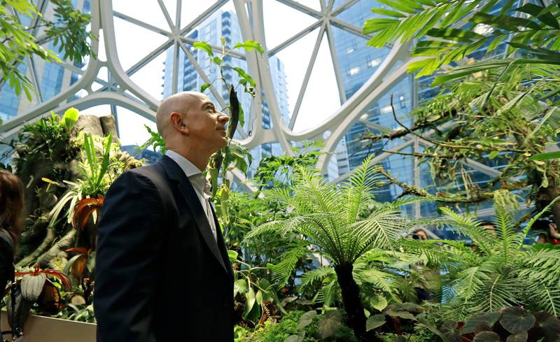 FILE - In this Jan. 29, 2018, file photo, Jeff Bezos, the CEO and founder of Amazon.com, takes a walking tour of the Amazon Spheres in Seattle. Bezos said Monday, Feb. 17, 2020, that he plans to spend $10 billion of his own fortune to help fight climate change. Bezos, the world's richest man, said in an Instagram post that he'll start giving grants this summer to scientists, activists and nonprofits working to protect the earth. (AP Photo/Ted S. Warren, File)