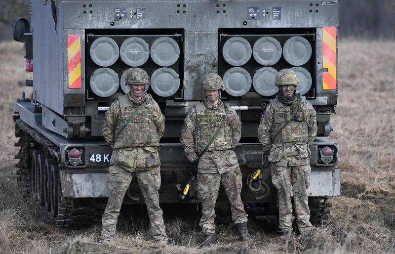 """(FILES) In this file photo taken on March 07, 2018 British artillery soldiers are pictured after a shooting session during the 'Dynamic Front 18' exercise in Grafenwoehr, near Eschenbach, southern Germany.  Russia's ambassador to Britain said on March 21, 2021 that diplomatic ties between the two countries were """"nearly dead"""", after a UK strategic review this week branded Moscow an """"acute direct threat"""". Andrei Kelin also criticised Britain's decision to bolster its nuclear stockpile, arguing the reversal of decades of policy was a violation of various international agreements.  / AFP / CHRISTOF STACHE"""
