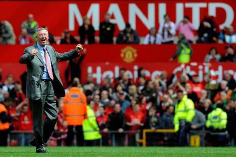 (FILES) Photo taken on May 16, 2009 of Manchester United's Scottish manager Sir Alex Ferguson celebrating on the pitch after his team drew 0-0 with Arsenal to clinch the Premier League Championship at Old Trafford, Manchester. Sir Alex Ferguson celebrates 25 years in charge of Manchester United on November 6, 2011, undaunted by the possibility that the greatest challenges of an extraordinary career may yet lie ahead of him.  AFP PHOTO/ADRIAN DENNIS.  FOR EDITORIAL USE ONLY Additional licence required for any commercial/promotional use or use on TV or internet (except identical online version of newspaper) of Premier League/Football League photos. Tel DataCo +44 207 2981656. Do not alter/modify photo.  *** Local Caption ***  206181-01-08.jpg