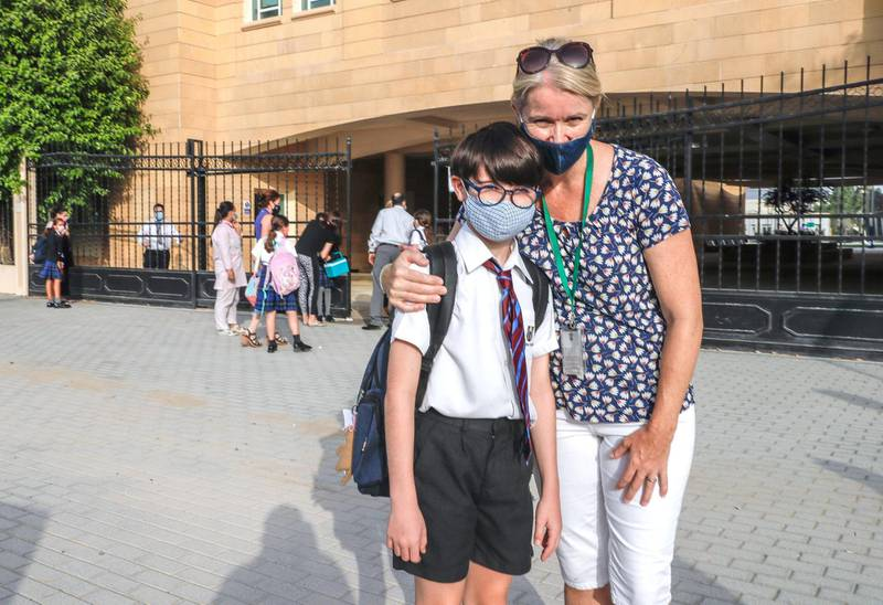Abu Dhabi, United Arab Emirates, August 30, 2020.  Children return to school on Sunday after months off due to the Covid-19 pandemic at the Brighton College, Abu Dhabi.--  Johnny Archer, nine and mother, Anna.Victor Besa /The NationalSection:  NAReporter:  Haneen Dajani