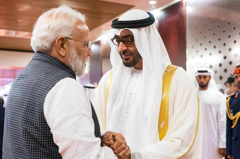 """A handout image provided by the United Arab Emirates News Agency (WAM) on August 24, 2019,  shows Mohamed bin Zayed al-Nahyan (R), Crown Prince of Abu Dhabi and Deputy Supreme Commander of the UAE Armed Forces (R) and Indian Prime Minister Narendra Modi (L), meeting  in the UAE capital. === RESTRICTED TO EDITORIAL USE - MANDATORY CREDIT """"AFP PHOTO / HO / WAM"""" - NO MARKETING NO ADVERTISING CAMPAIGNS - DISTRIBUTED AS A SERVICE TO CLIENTS ===  / AFP / WAM / STRINGER / === RESTRICTED TO EDITORIAL USE - MANDATORY CREDIT """"AFP PHOTO / HO / WAM"""" - NO MARKETING NO ADVERTISING CAMPAIGNS - DISTRIBUTED AS A SERVICE TO CLIENTS ==="""