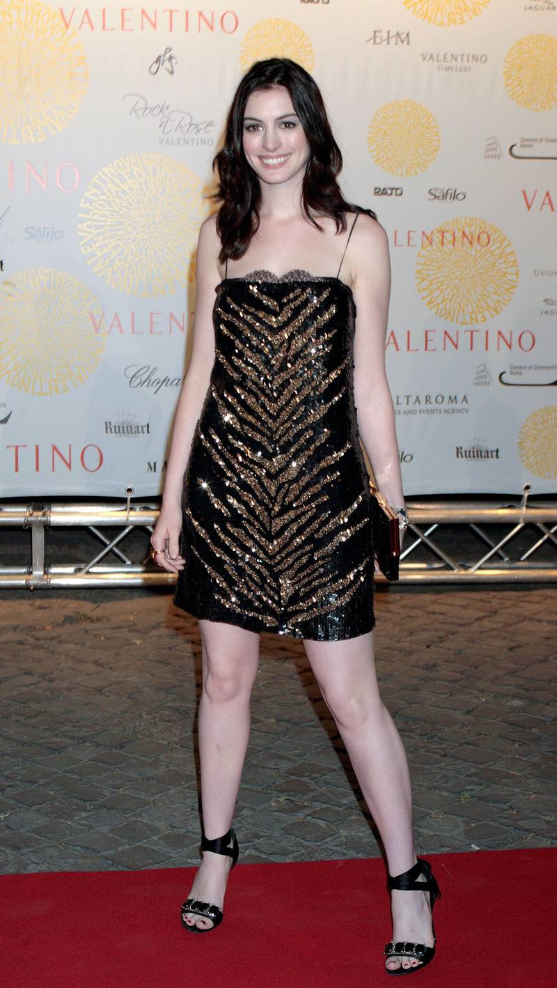 ROME, ITALY - JULY 6:  Anne Hathaway arrives at the 'Valentino In Rome, 45 Years Of Style' post-exhibit gala dinner at the Temple of Venus in the Imperial Forum July 6, 2007 in Rome, Italy. Fashion icon Valentino decided to mark the celebration of the 45th anniversary of his luxury brand by breaking a 17-year tradition of unveiling his luxurious haute couture collections for women in Paris with a show in Rome. (Photo by Elisabetta Villa /Getty Images)
