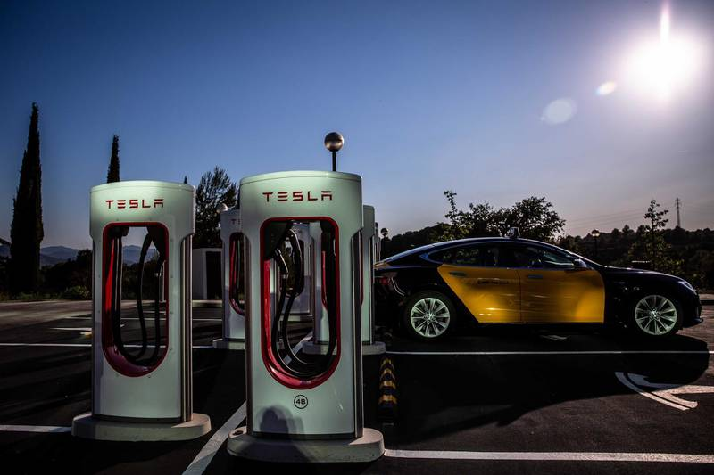 A Tesla Inc. Model S electric taxi vehicle charges at a Supercharger station in Sant Cugat, Spain, on Wednesday, July 10, 2019. Tesla is poised to increase production at its California car plant and is back in hiring mode, according to an internal email sent days after the company wrapped up a record quarter of deliveries. Photographer: Angel Garcia/Bloomberg