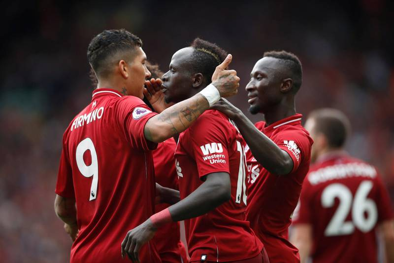 """Soccer Football - Premier League - Liverpool v West Ham United - Anfield, Liverpool, Britain - August 12, 2018   Liverpool's Sadio Mane celebrates with Roberto Firmino and Naby Keita after scoring their third goal     Action Images via Reuters/Carl Recine    EDITORIAL USE ONLY. No use with unauthorized audio, video, data, fixture lists, club/league logos or """"live"""" services. Online in-match use limited to 75 images, no video emulation. No use in betting, games or single club/league/player publications.  Please contact your account representative for further details."""