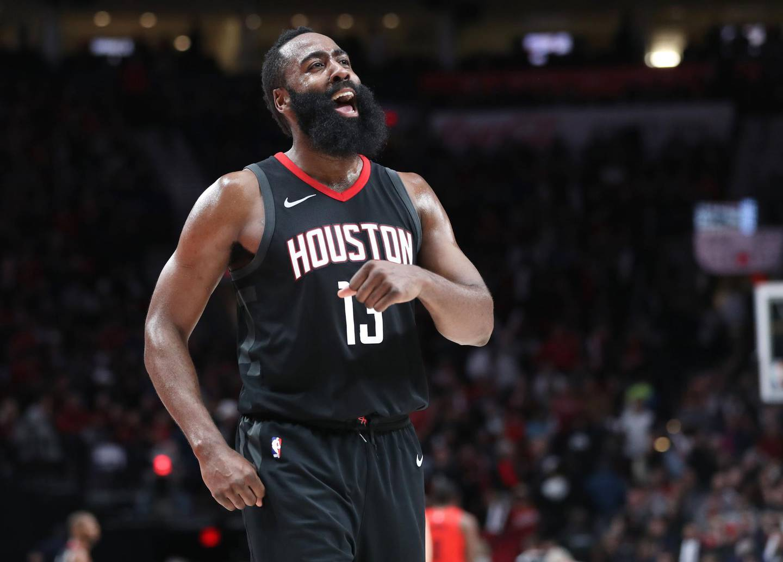 Dec 9, 2017; Portland, OR, USA; Houston Rockets guard James Harden (13) celebrates the 124-117 win over the Portland Trail Blazers at Moda Center. Mandatory Credit: Jaime Valdez-USA TODAY Sports