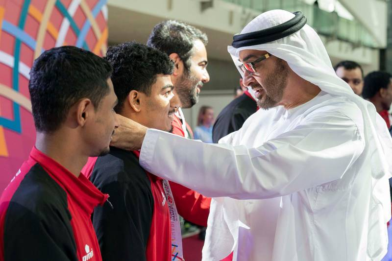 ABU DHABI, UNITED ARAB EMIRATES - March 18, 2019: HH Sheikh Mohamed bin Zayed Al Nahyan, Crown Prince of Abu Dhabi and Deputy Supreme Commander of the UAE Armed Forces (R) presents a medal to an athlete during the Special Olympics World Games Abu Dhabi 2019, at Abu Dhabi National Exhibition Centre (ADNEC).  ( Ryan Carter / Ministry of Presidential Affairs )? ---