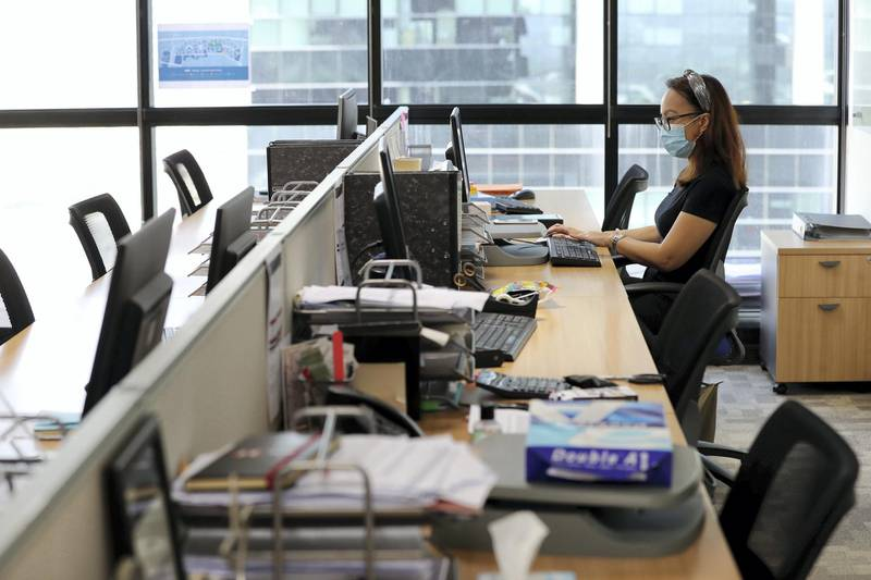 Dubai, United Arab Emirates - Reporter: Patrick Ryan: News. Kristine Angus works at her desk with her mask on. How firms are social distancing staff who are back in the office working. Thursday, May 21st, 2020. Dubai. Chris Whiteoak / The National